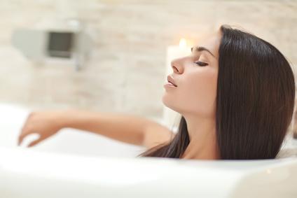 Beautiful woman relaxing in the bathroom